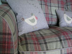 Mary's sofa with clucky cushions