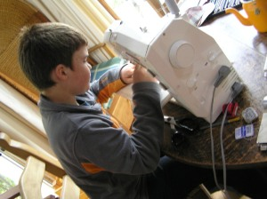 Tom sewing Rabbit legs!