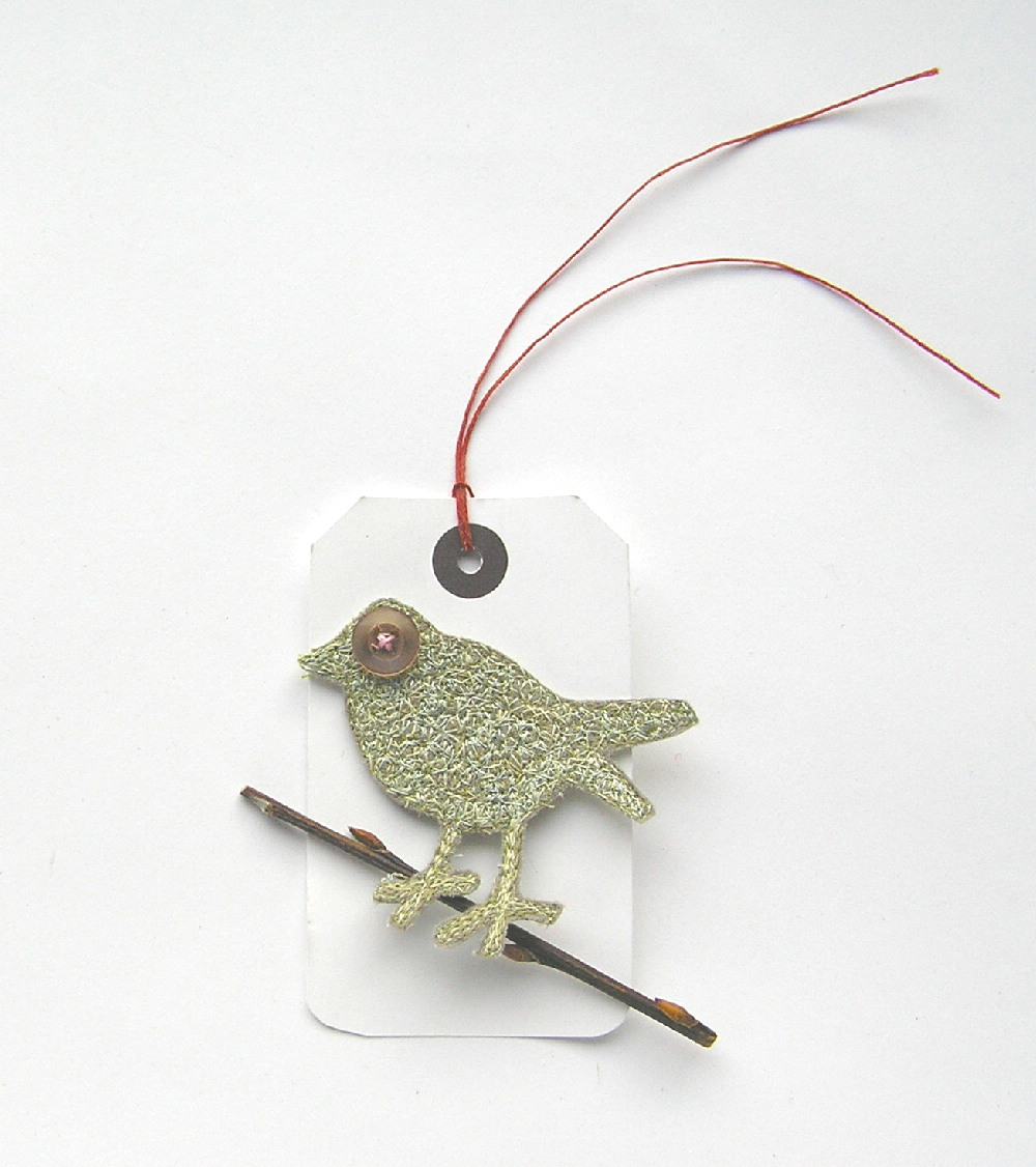 Birdy brooch heading to Hampstead.