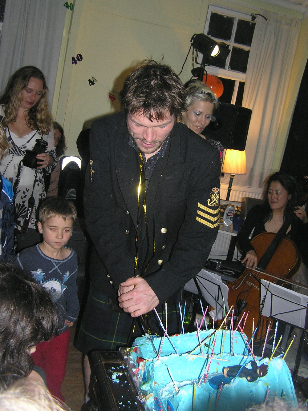 Conrad cutting his cake