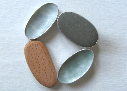 OK, so it's not a ring but browsing through the Origin exhibitor list I came across this beautiful work by Grace Girvan No web site but I'll get in touch and see whether she makes rings. I love these textures and remember chatting to her at Origin 2007 about where we collected pebbles from.