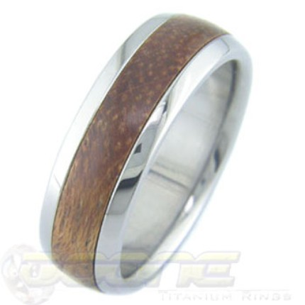 This one is titanium with wood, just a bit that the wood might not cope too well with manure digging and washing dishes